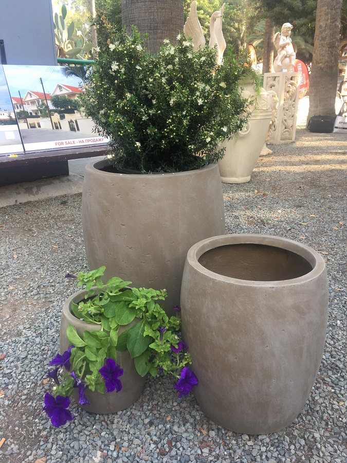 Change the look of your garden by placing beautiful flower- pots!
